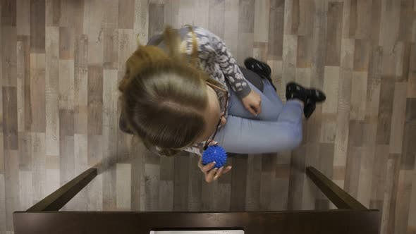 Thumbnail for Girl Spinning on Office Chair with Antistress Ball