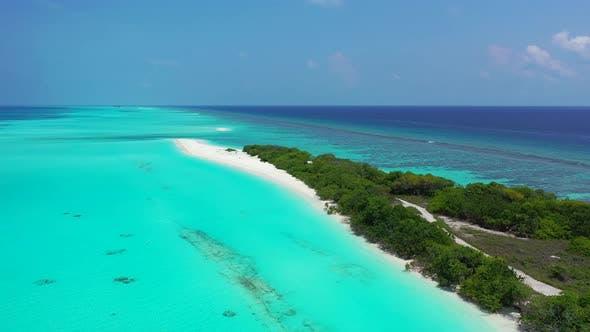 Wide angle overhead tourism shot of a paradise sunny white sand beach and aqua turquoise
