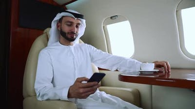 Arabian man flying on his Private jet to dubai.