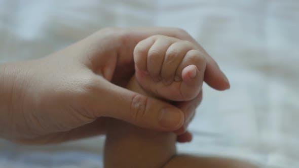 Hand Mom And Newborn Baby