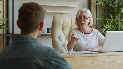 Elderly Female Boss Communicate with Subordinate. Recruiting New Candidate at Job Interview