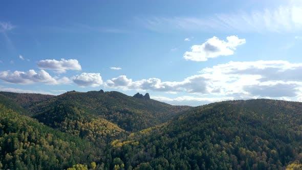 Aerial Hyperlapse of Autumn Forest on a Mountain Range.