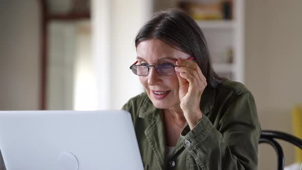 Old Elderly Successful Businesswoman Using Laptop at Home Living Room Home Office Spbi