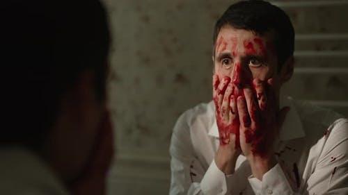 Maniac Rubs Blood Across His Face