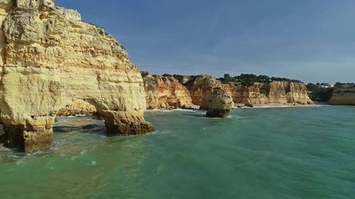 Aerial View on Rock Cliffs and Waves in Portugal