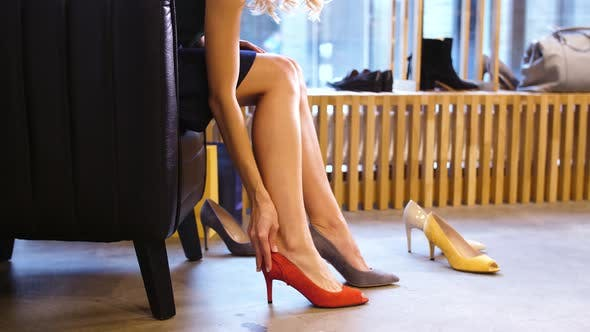 Thumbnail for Young Woman Trying Heeled Shoes at Store
