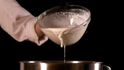 Milk is Poured Into the Pot