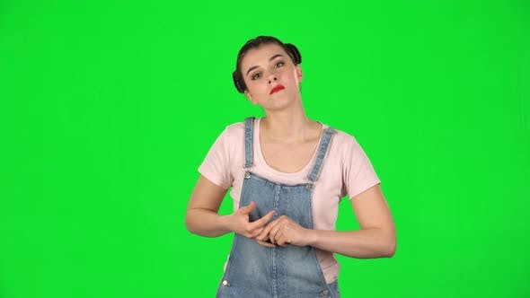 Thumbnail for Girl Stands Waiting on a Green Screen