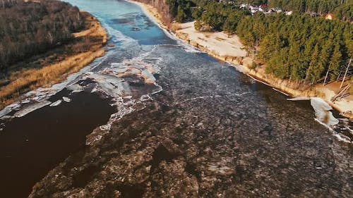 Spring Aerial View Over River Joining Baltic Sea with Melting Ice and Snow with People