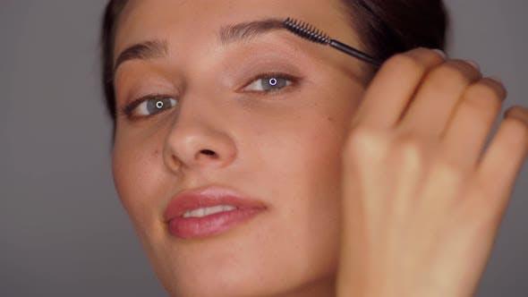 Thumbnail for Face of Beautiful Young Woman Applying Mascara