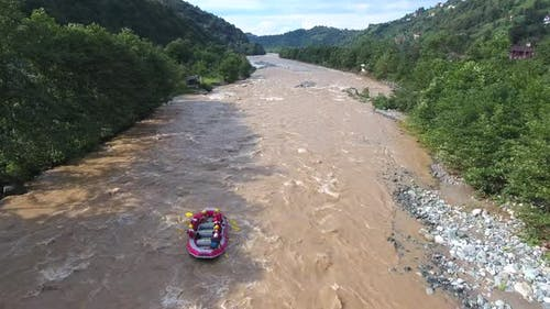 Aerial Following the Rafting Boat