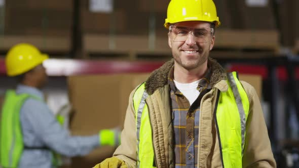 Thumbnail for Portrait of industry worker in shipping warehouse