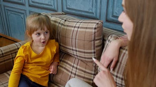 Professional Speech Therapist Woman Teaching Pronunciation Little Child Girl with Voice Problems
