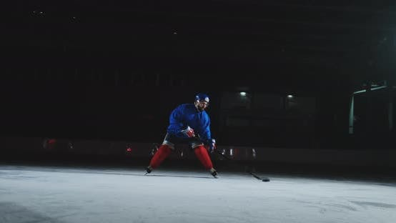 Thumbnail for Two Professional Hockey Men Fighting for the Puck on the Ice Arena Using Force Techniques