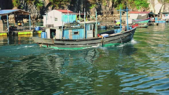 Thumbnail for A Vietnamese Fishing Boat At The Base Of Cliffs In Halong Bay