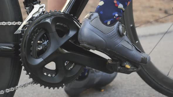 Thumbnail for Leg in cycling road shoes clips out from pedals. Cycling concept