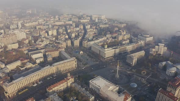 Maidan Nezalezhnosti Square in the Fog and Smog. Independence Monument in Kiev Ukraine