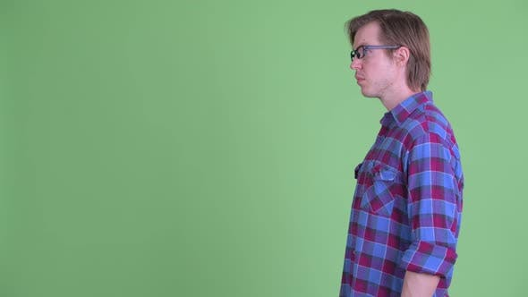 Thumbnail for Profile View of Young Handsome Hipster Man with Eyeglasses