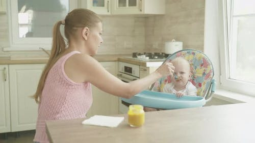 Mother Woman Feeding Baby Her Kitchen Table Spoon