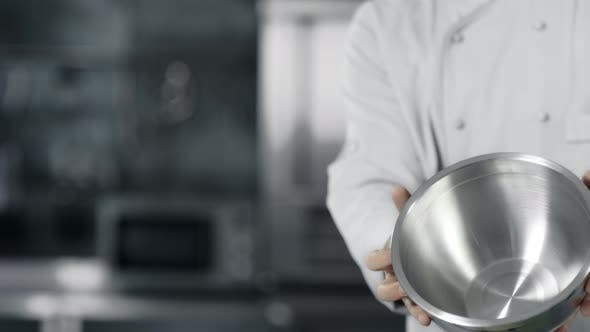 Thumbnail for Chef Hands Having Fun with Steel Bowl in Slow Motion. Chef Man Preparing To Cook