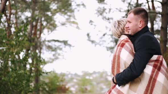 Thumbnail for Porait of Couple Covered with Blanket Embracing in Forest