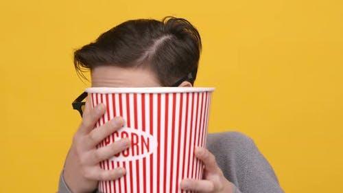 Boy Watching Horror Movie Hiding Behind Popcorn Bucket Yellow Background