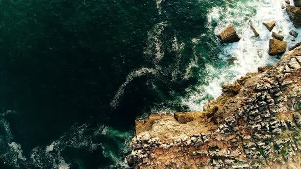 Cover Image for Aerial Top View on Ocean Waves on Portugal Coast
