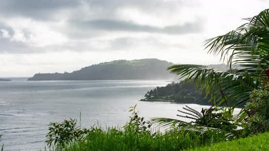 Thumbnail for Kauai Waterfront Mist Rain Sun Rays Timelapse Palm Trees Island View