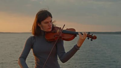 Woman Soloist Is Playing Violin