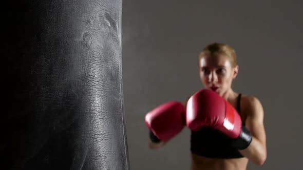 Thumbnail for Sportswoman Boxer Knocks Out of the Punching Bag. Slow Motion