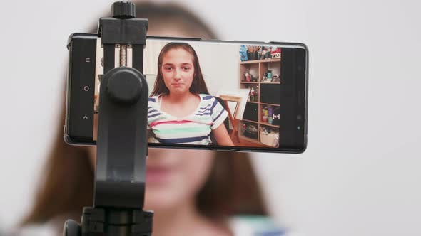 Thumbnail for Teenage Girl Filming Herself on a Smartphone