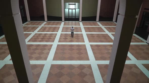 Thumbnail for Middle-aged Man Is in a Large Hall with Columns, Holding a Phone and Dials the Message