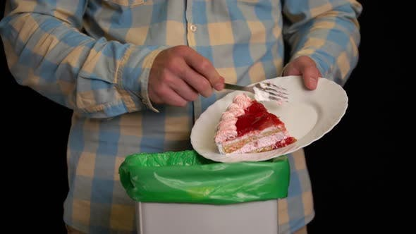 Thumbnail for Man Scraping with a Plate a Strawberry Cake Into Garbage Bin