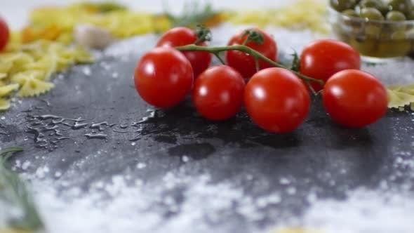 Thumbnail for Wet Tomatoes on Twig Being Dropped on Kitchen Table