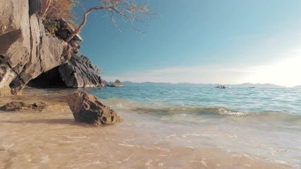 Seascape Ocean and Beautiful Beach, Rocks on Sandy Beach with Blue Sea Waves on Sunny Day, Palawan