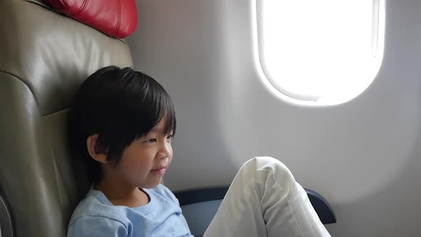 Asian Child Traveling By An Airplane Slow Motion
