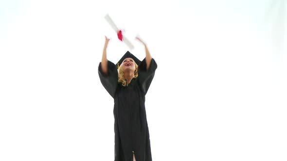 Thumbnail for Young woman in graduation gown holding diploma