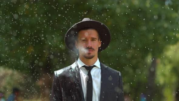 Thumbnail for Man smoking in the rain, slow motion