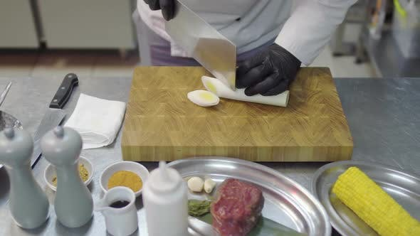 Thumbnail for Chefs Hands in Black Latex Gloves Cutting Slices of Lemon Grass in Cutting Board