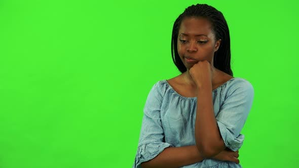 Thumbnail for A Young Black Woman Is Langeweile - Green Screen Studio