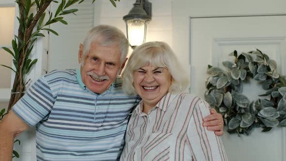 Thumbnail for Senior Couple Husband and Wife Embracing and Laughing in Porch at Home. Happy Mature Family