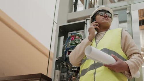 Construction Worker with Docs Phone Calling