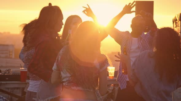 Cover Image for Multi-ethnic Friends Celebrating at Sunset