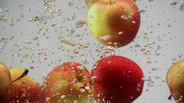 Thumbnail for Fresh Fruits Apples Red and Yellow Falling in Water Spin and Rotating with Air Bubbles