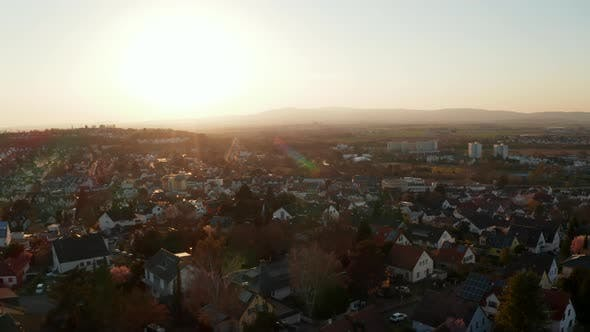 Aerial Drone View of Small Town Against Setting Sun