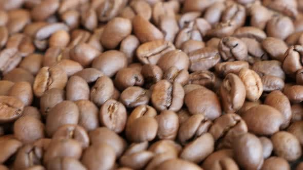 Thumbnail for Arabica type coffee beans on table slow dolly shoot moving 4K 3840X2160 UltraHD footage - Camera on