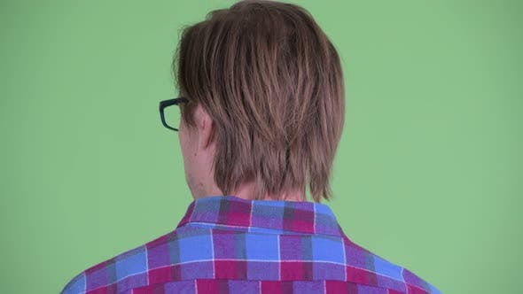 Thumbnail for Closeup Rear View of Young Hipster Man Looking Around