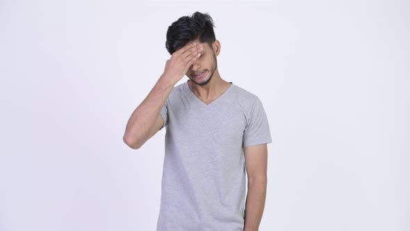 Thumbnail for Young Stressed Bearded Indian Man Having Headache