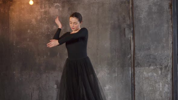 A Young Woman Attempts To Dance a Ballet Performs Graceful Movements