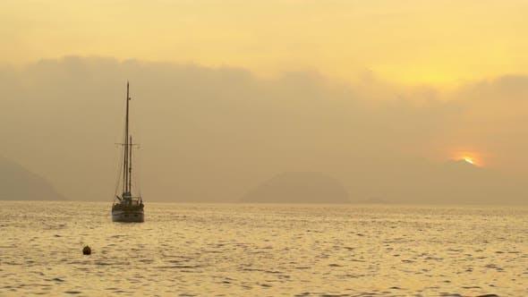 Static shot of floating boat and bouy at sea near Rio de Janeiro, Brazil